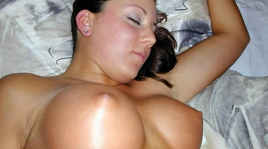 Big perky tits exposed on this sleeping brunette girl